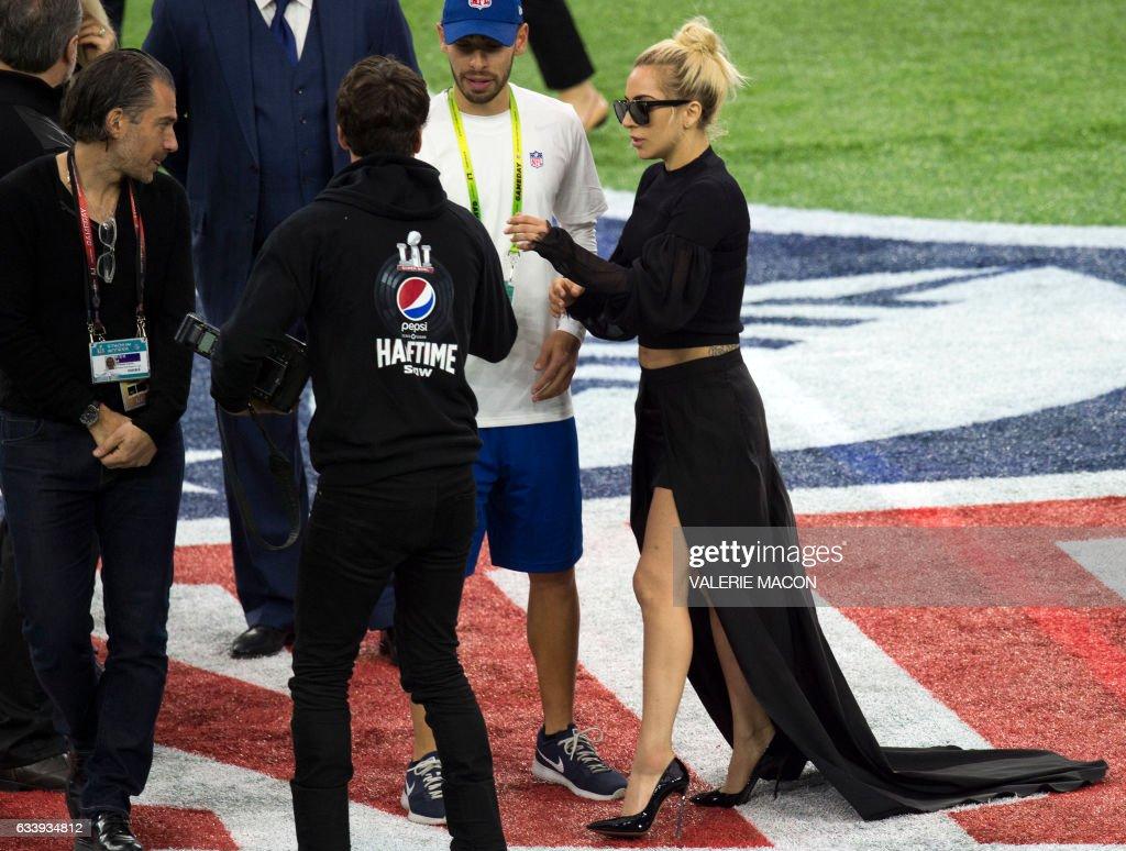 Singer Lady Gaga walks on the field before Super Bowl LI at Houston NRG Stadium in Houston, Texas, February 5, 2017. / AFP / VALERIE