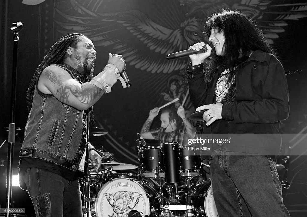 Singer Lajon Witherspoon and drummer Morgan Rose of Sevendust are joined onstage by singer Joey Belladonna of Anthrax as they perform the song 'Face to Face' during a stop of Sevendust's Kill the Flaw tour at Brooklyn Bowl Las Vegas at The Linq Promenade on October 24, 2016 in Las Vegas, Nevada.