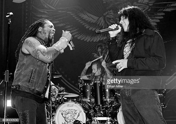 Singer Lajon Witherspoon and drummer Morgan Rose of Sevendust are joined onstage by singer Joey Belladonna of Anthrax as they perform the song 'Face...