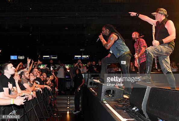 Singer Lajon Witherspoon guitarist Clint Lowery and bassist Vince Hornsby of Sevendust perform during a stop of the band's Kill the Flaw tour at...