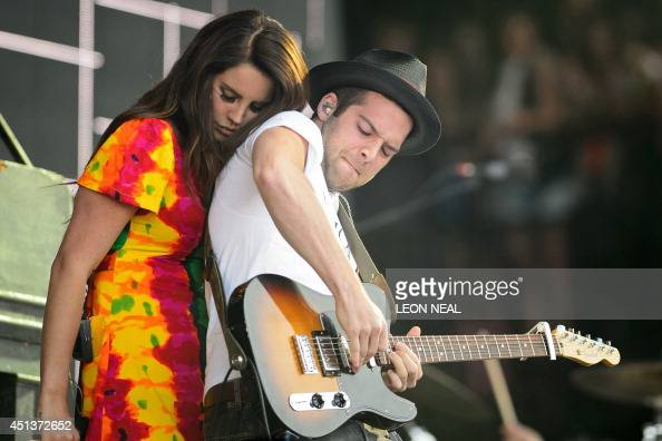US singer Lana Del Rey interacts with her guitarist as she performs on the Pyramid Stage on the second day of the Glastonbury Festival of Music and...