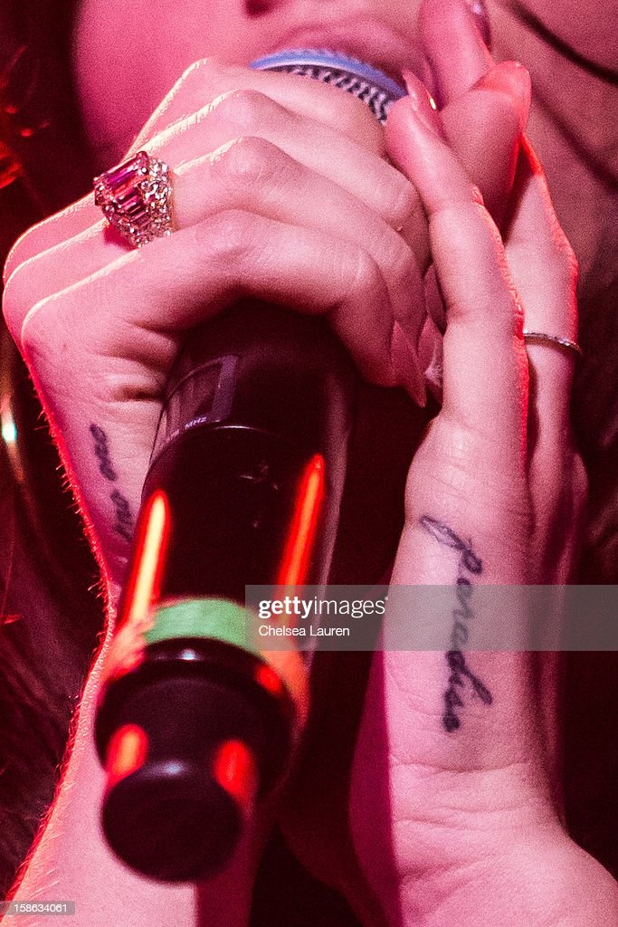 Singer Lana Del Rey (tattoo and ring detail) performs at Camp Freddy's holiday residency at The Roxy Theatre on December 21, 2012 in West Hollywood, California.