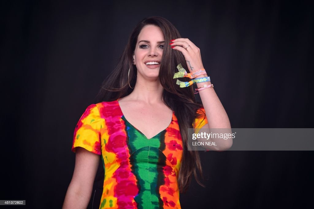 US singer Lana Del Rey performs on the Pyramid Stage, on the second day of the Glastonbury Festival of Music and Performing Arts in Somerset, southwest England, on June 28, 2014. US metal giants Metallica will play this year's coveted Saturday night headline spot at Britain's Glastonbury festival, organisers announced Thursday. It will be the 'Master of Puppets' four-piece's first appearance at the legendary festival, held in south west England, following on from The Rolling Stones' Worthy Farm debut last year. AFP PHOTO / LEON NEAL