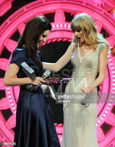 Singer Lana Del Rey presents the award for Best Female to winner Taylor Swift during the MTV EMA's 2012 at Festhalle Frankfurt on November 11 2012 in...