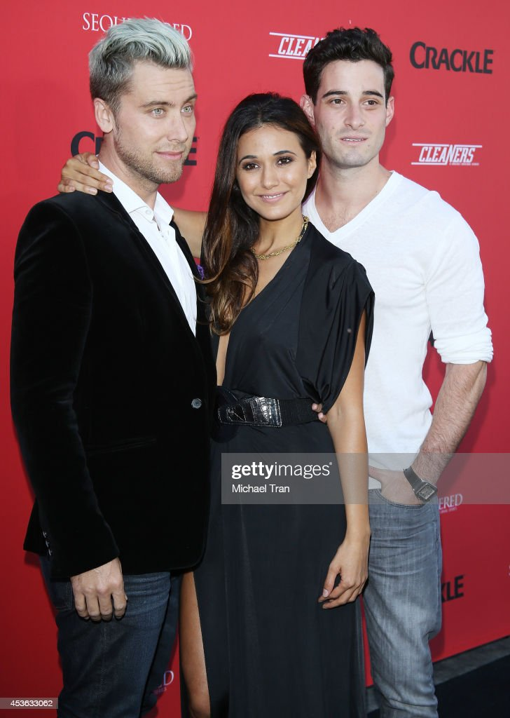 Singer <a gi-track='captionPersonalityLinkClicked' href=/galleries/search?phrase=Lance+Bass&family=editorial&specificpeople=210566 ng-click='$event.stopPropagation()'>Lance Bass</a>, actress <a gi-track='captionPersonalityLinkClicked' href=/galleries/search?phrase=Emmanuelle+Chriqui&family=editorial&specificpeople=541098 ng-click='$event.stopPropagation()'>Emmanuelle Chriqui</a> and <a gi-track='captionPersonalityLinkClicked' href=/galleries/search?phrase=Michael+Turchin&family=editorial&specificpeople=7817442 ng-click='$event.stopPropagation()'>Michael Turchin</a> arrive at the Crackle Original Series' 'Cleaners' and 'Sequestered' Summer premiere celebration held at 1 OAK on August 14, 2014 in West Hollywood, California.