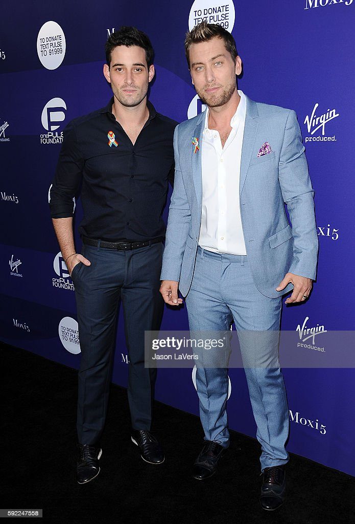 Singer Lance Bass (R) and husband Michael Turchin attend a benefit for onePULSE Foundation at NeueHouse Hollywood on August 19, 2016 in Los Angeles, California.