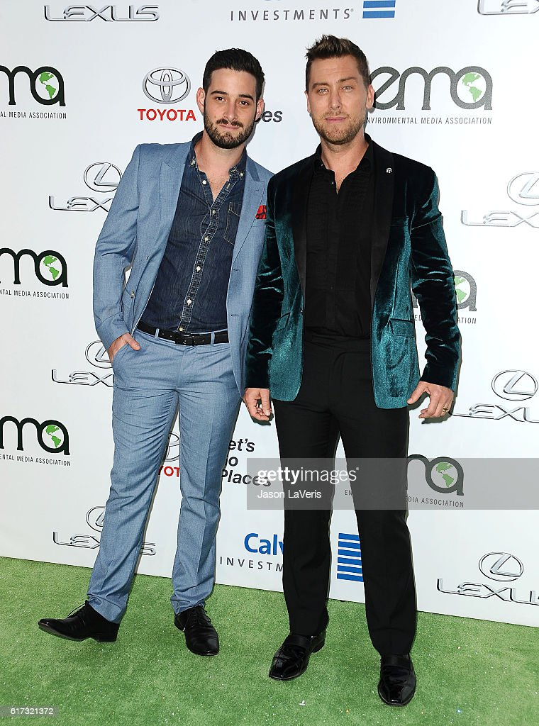 Singer Lance Bass (R) and husband Michael Turchin attend the 26th annual EMA Awards at Warner Bros. Studios on October 22, 2016 in Burbank, California.