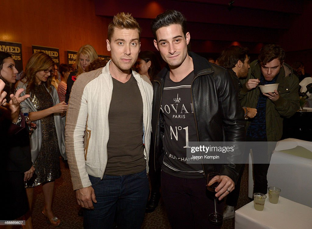Singer Lance Bass (L) and Michael Turchin celebrate the world premiere of 'Farmed and Dangerous,' a Chipotle/Piro production at DGA Theater on February 11, 2014 in Los Angeles, California.