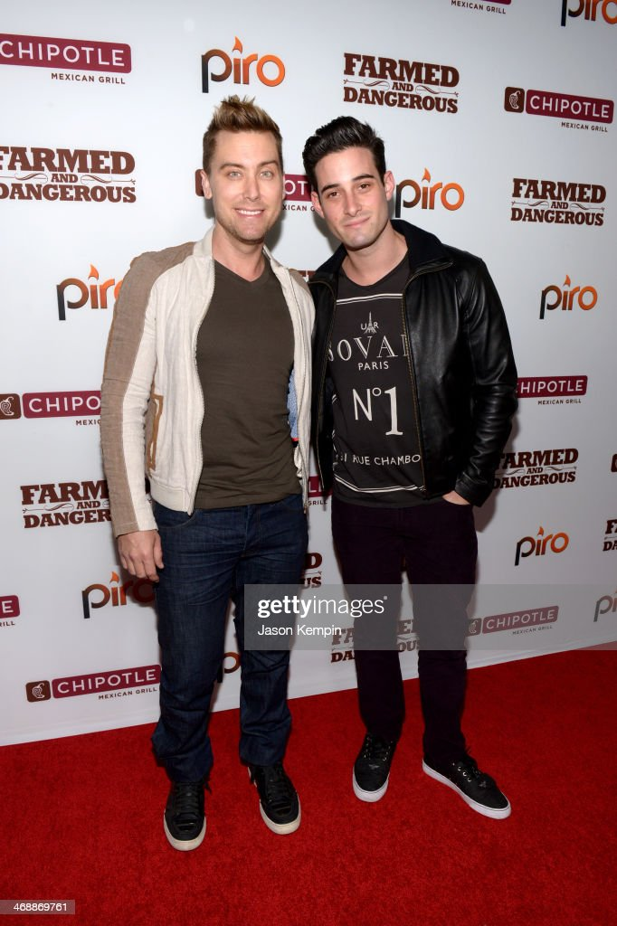 Singer Lance Bass (L) and Michael Turchin walk the red carpet at the world premiere of 'Farmed and Dangerous,' a Chipotle/Piro production at DGA Theater on February 11, 2014 in Los Angeles, California.