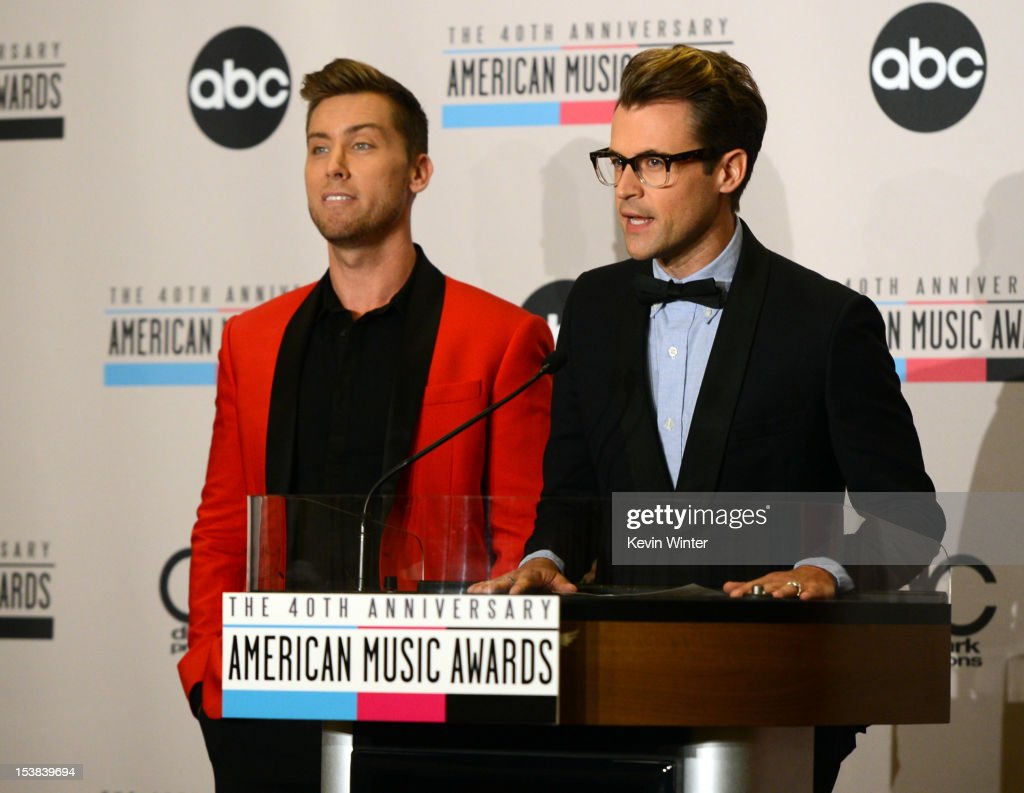Singer Lance Bass (L) and stylist Brad Goreski speak onstage during the 40th Anniversary American Music Awards nominations press conference at the JW Marriott Los Angeles at L.A. LIVE on October 9, 2012 in Los Angeles, California.