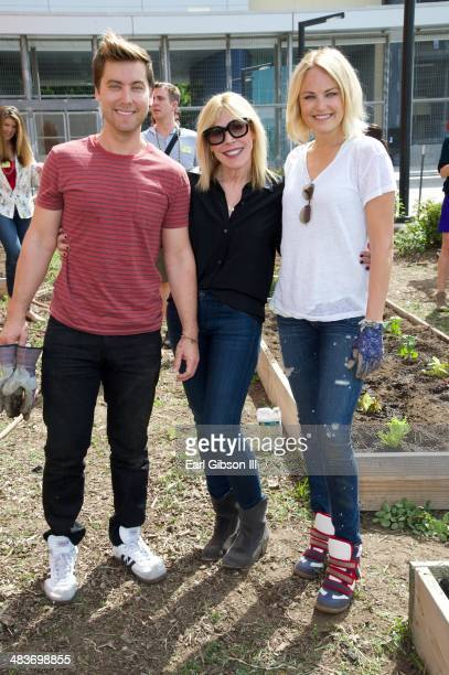 Singer Lance Bass EMA president Debbie Levin and actress Malin Akerman lend a helping hand for Nature Works Everywhere Gardens Program at Helen...