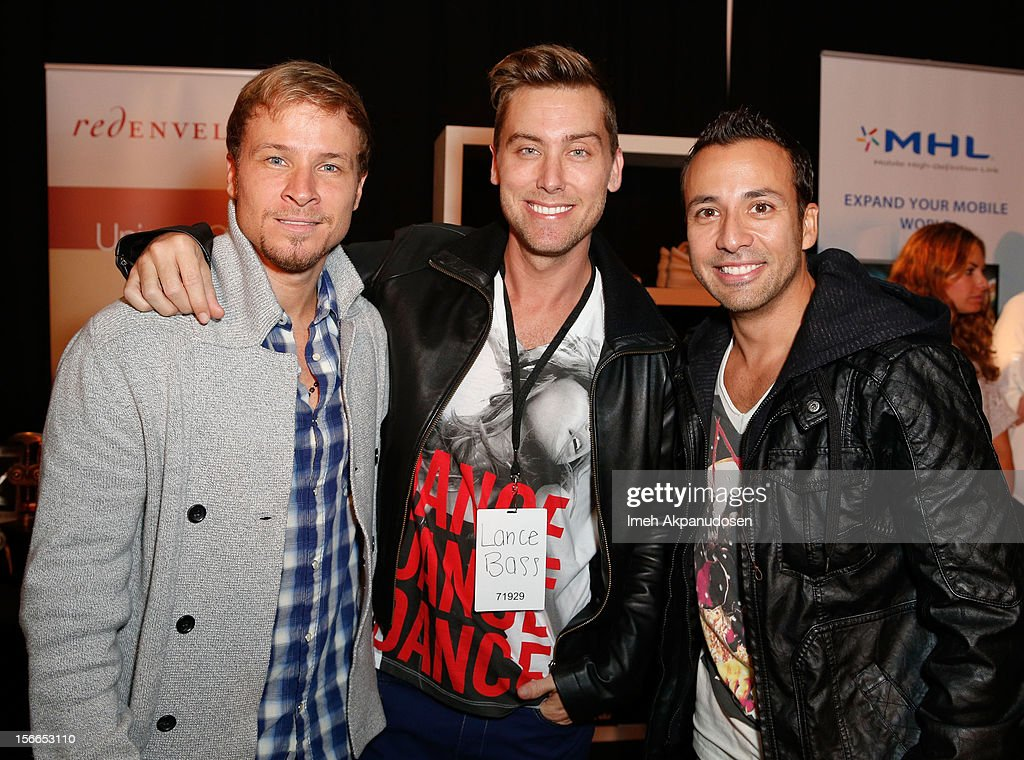 Singer <a gi-track='captionPersonalityLinkClicked' href=/galleries/search?phrase=Lance+Bass&family=editorial&specificpeople=210566 ng-click='$event.stopPropagation()'>Lance Bass</a> (C) with singers <a gi-track='captionPersonalityLinkClicked' href=/galleries/search?phrase=Brian+Littrell&family=editorial&specificpeople=215310 ng-click='$event.stopPropagation()'>Brian Littrell</a> (L) and <a gi-track='captionPersonalityLinkClicked' href=/galleries/search?phrase=Howie+Dorough&family=editorial&specificpeople=204770 ng-click='$event.stopPropagation()'>Howie Dorough</a> from the musical group Backstreet Boys attend The Official AMA Artist Gift Lounge presented by LPB Group at Nokia Theatre L.A. Live on November 17, 2012 in Los Angeles, California.