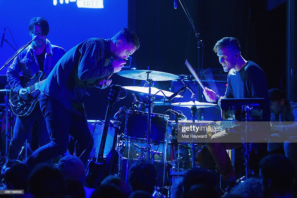 Singer Landon Jacobs and Drummer Hayden Coplan of Sir Sly perform on stage during the Sasquatch launch party at Neptune Theatre on February 3, 2014 in Seattle, Washington.
