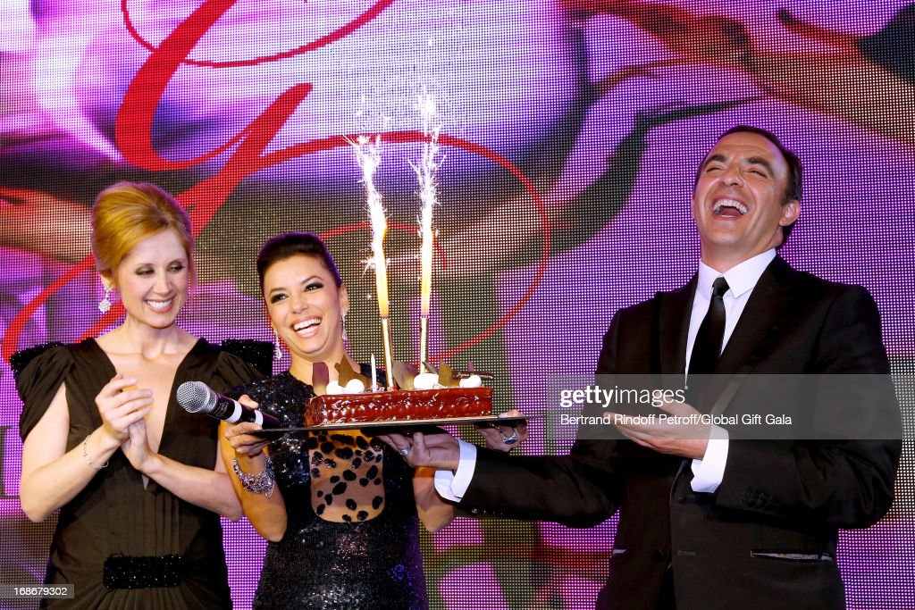 Singer Lara Fabian(L) and Eva Longoria (C) give a Birthday Cake to Nikos Aliagas (R) which has 44 years old today - 'Global Gift Gala' at Hotel George V on May 13, 2013 in Paris, France.