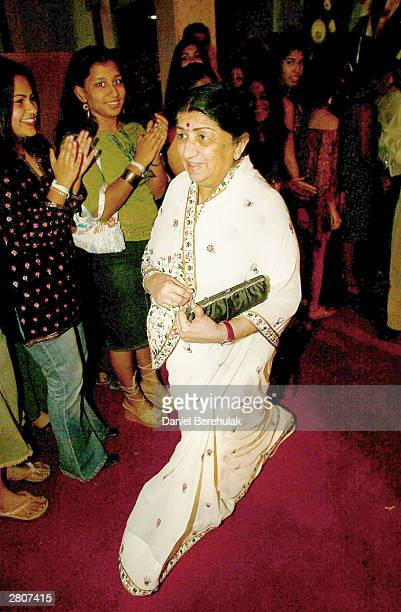 Singer Lata Mangeshkar arrives during the Inaugural MTV IMMIES at the Goregaon Sports Club December 12 2003 in Mumbai India