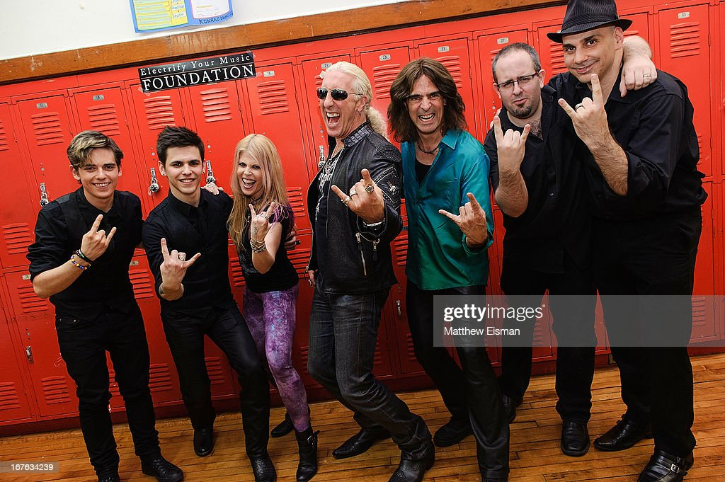 Singer Laura Kaye, <a gi-track='captionPersonalityLinkClicked' href=/galleries/search?phrase=Dee+Snider&family=editorial&specificpeople=239139 ng-click='$event.stopPropagation()'>Dee Snider</a> of the band Twisted Sister and Electrify Your Music Foundation Founder/ electric violinist Mark Wood pose with musicians for a photo backstage at the Electrify Your Music Foundation launch event at Brooklyn Technical High School Theater on April 26, 2013 in the Brooklyn borough of New York City.