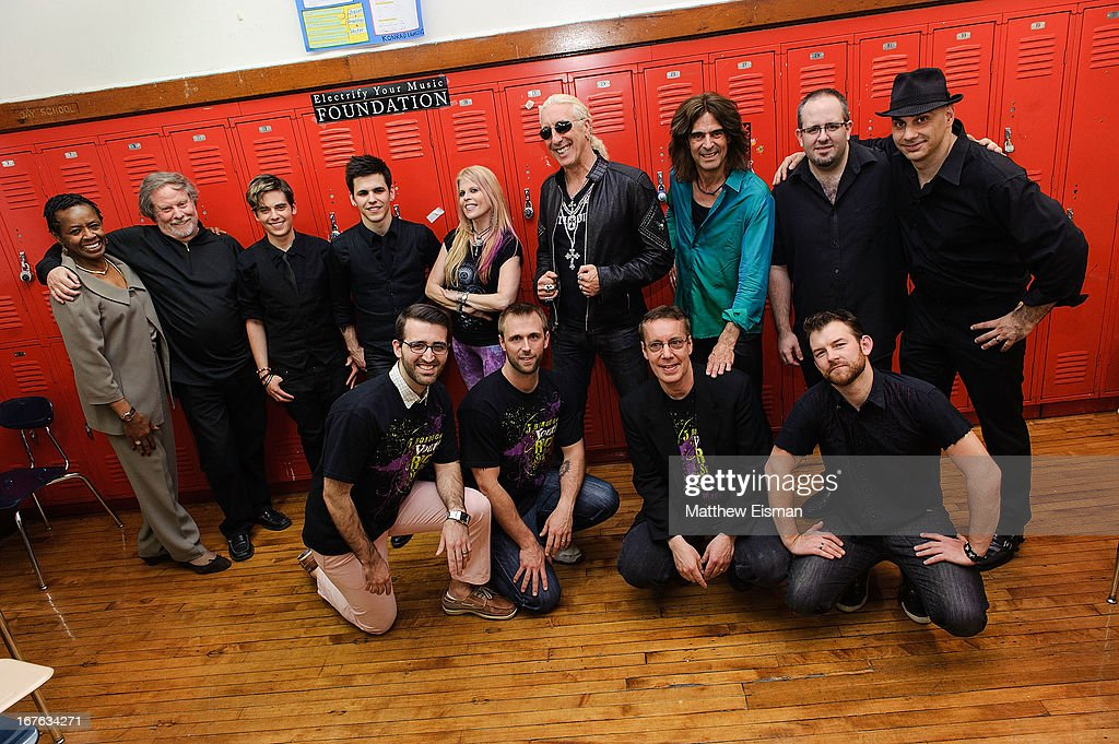 Singer Laura Kaye, Dee Snider of the band Twisted Sister and Electrify Your Music Foundation Founder/ electric violinist Mark Wood pose with musicians and teachers for a photo backstage at the Electrify Your Music Foundation launch event at Brooklyn Technical High School Theater on April 26, 2013 in the Brooklyn borough of New York City.