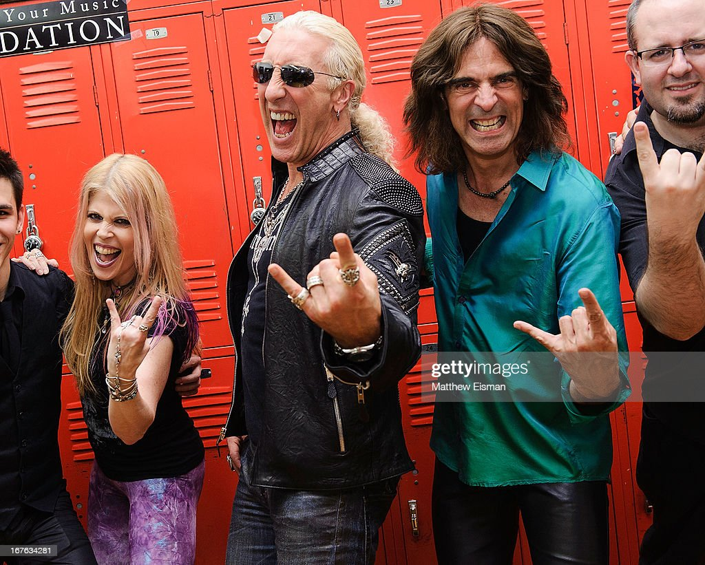 Singer Laura Kaye, Dee Snider of the band Twisted Sister and Electrify Your Music Foundation Founder/ electric violinist Mark Wood pose for a photo backstage at the Electrify Your Music Foundation launch event at Brooklyn Technical High School Theater on April 26, 2013 in the Brooklyn borough of New York City.