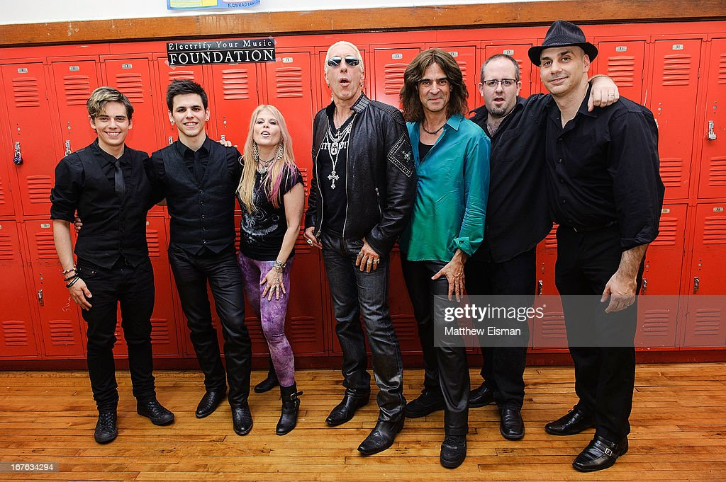 Singer Laura Kaye, Dee Snider of the band Twisted Sister and Electrify Your Music Foundation Founder/ electric violinist Mark Wood pose with musicians for a photo backstage at the Electrify Your Music Foundation launch event at Brooklyn Technical High School Theater on April 26, 2013 in the Brooklyn borough of New York City.