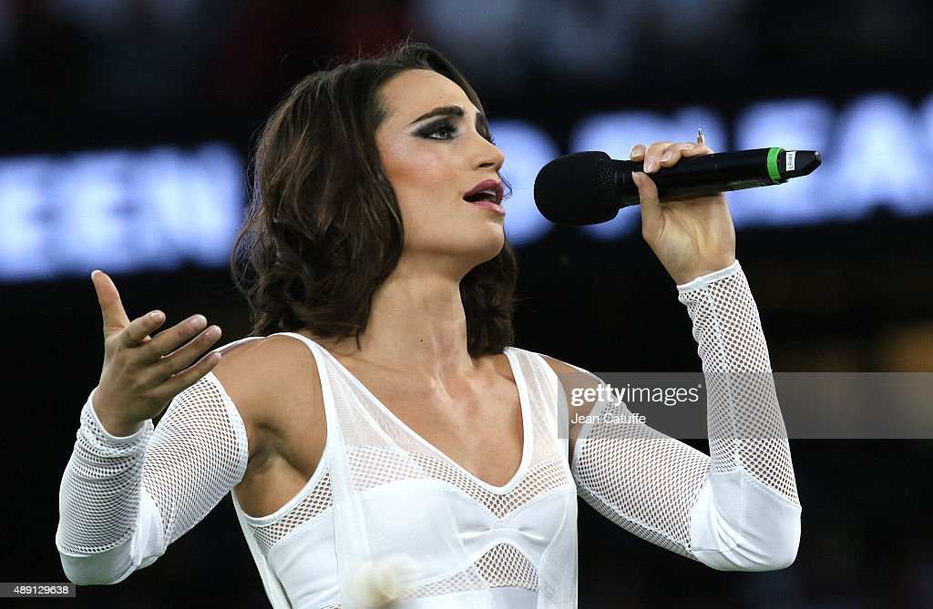 Singer <a gi-track='captionPersonalityLinkClicked' href=/galleries/search?phrase=Laura+Wright+-+Singer&family=editorial&specificpeople=15063715 ng-click='$event.stopPropagation()'>Laura Wright</a> performs during the opening ceremony of the Rugby World Cup 2015 match between England v Fiji at Twickenham Stadium on September 18, 2015 in London, England.