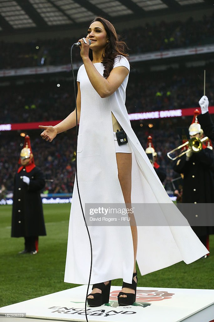 Singer Laura Wright sings the national anthem ahead of the RBS Six Nations match between England and France at Twickenham Stadium on February 23, 2013 in London, England.