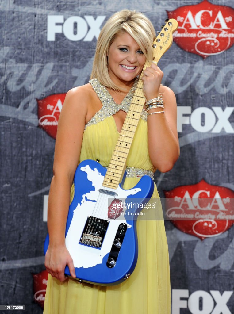 Singer Lauren Alaina poses in the press room with her award for New Artist of the Year during the 2012 American Country Awards at the Mandalay Bay Events Center on December 10, 2012 in Las Vegas, Nevada.
