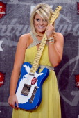 Singer Lauren Alaina poses in the press room with her award for New Artist of the Year during the 2012 American Country Awards at the Mandalay Bay...