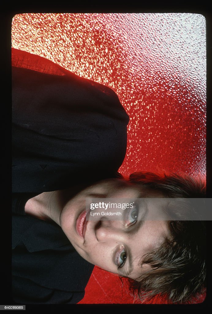 Singer Laurie Anderson. Anderson is shown in a headshot view with a red background.