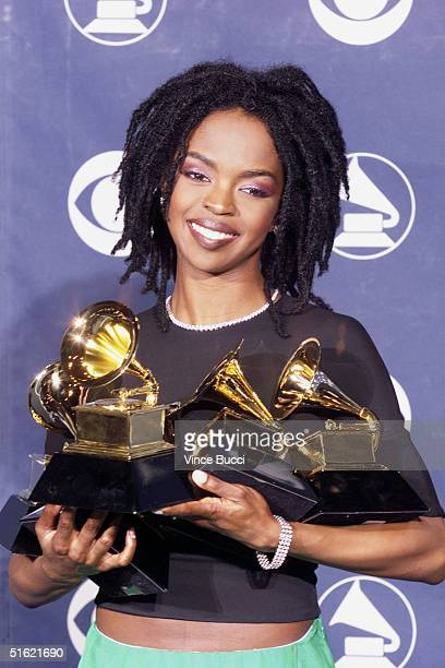 Singer Lauryn Hill poses with her five Grammy awards including Album of the Year for 'The Miseducation of Lauryn Hill' at the 41st Annual Grammy...