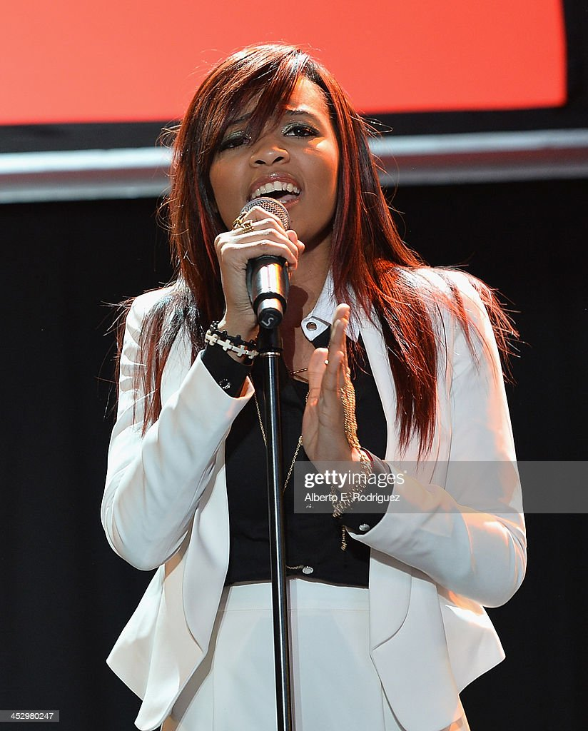 Singer Lauryn McClain performs at the 82nd Annual Hollywood Christmas Parade on December 1, 2013 in Hollywood, California.