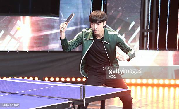Singer Lay Zhang Yixing performs onstage during the new year countdown part held by Shanghai Dragon TV on December 31 2016 in Shanghai China