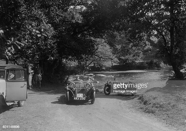 Singer Le Mans and MG D type at the Mid Surrey AC Barnstaple Trial Tarr Steps Exmoor 1934 Artist Bill BrunellCentre Singer Le Mans 1933 972 cc Reg No...