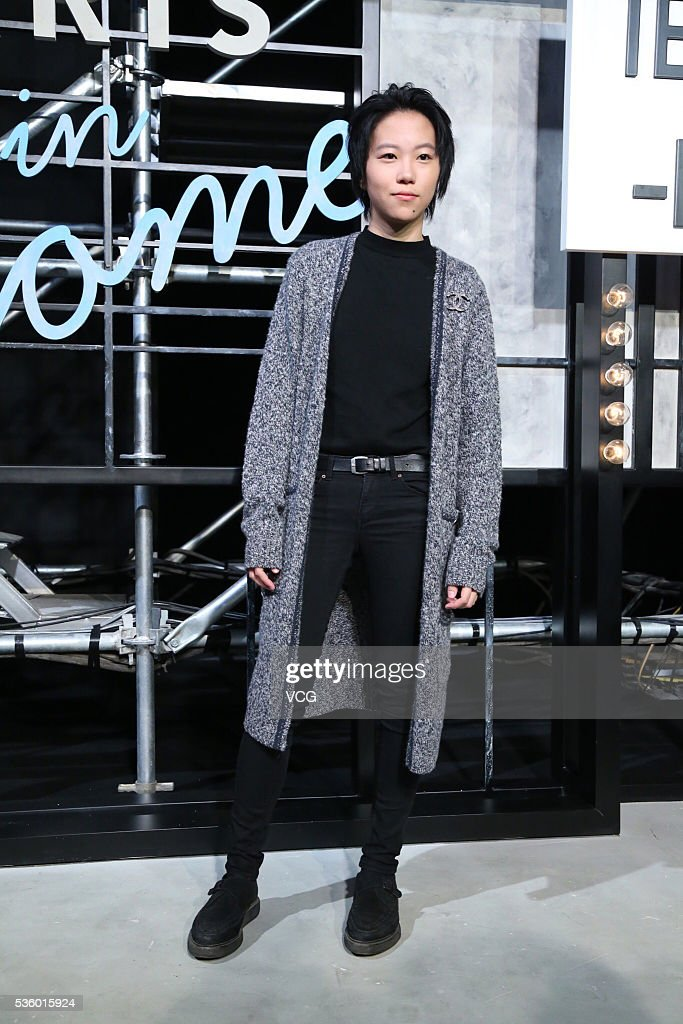 Singer Leah Dou arrives at the red carpet of a press conference of Chanel's 'Paris in Rome 2015/16' Metiers d'Art Show on May 31, 2016 in Beijing, China.