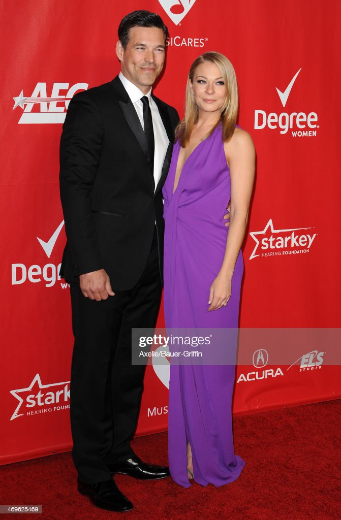 Singer LeAnn Rimes (R) and actor Eddie Cibrian attend the 2014 MusiCares Person Of The Year honoring Carole King at Los Angeles Convention Center on January 24, 2014 in Los Angeles, California.