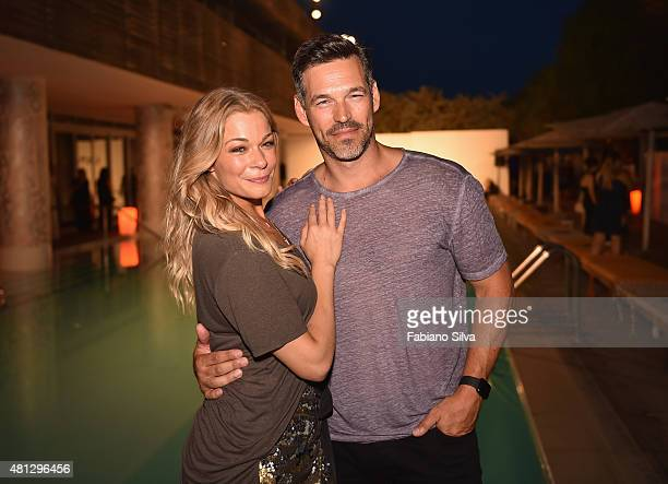 Singer LeAnn Rimes and Eddie Cibrian attend the Maxim Magazine Worldwide Swimwear Collection launch at SLS South Beach on July 18 2015 in Miami...