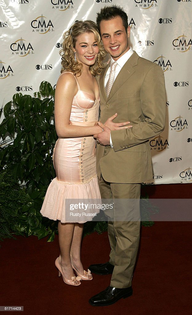 Singer Leann Rimes and her husband Dean Sheremet arrive at the 38th Annual CMA Awards at the Grand Ole Opry House November 9, 2004 in Nashville, Tennessee.