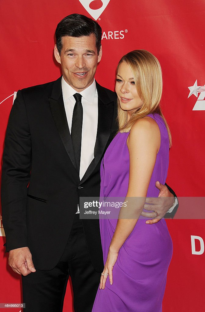 Singer LeAnn Rimes (R) and husband, actor Eddie Cibrian attend 2014 MusiCares Person Of The Year Honoring Carole King at Los Angeles Convention Center on January 24, 2014 in Los Angeles, California.