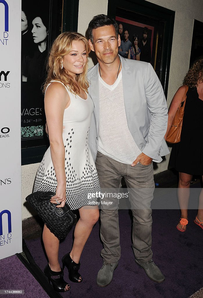 Singer LeAnn Rimes (L) and husband actor Eddie Cibrian attend the Friend Movement Anti-Bullying Benefit Concert at the El Rey Theatre on July 1, 2013 in Los Angeles, California.