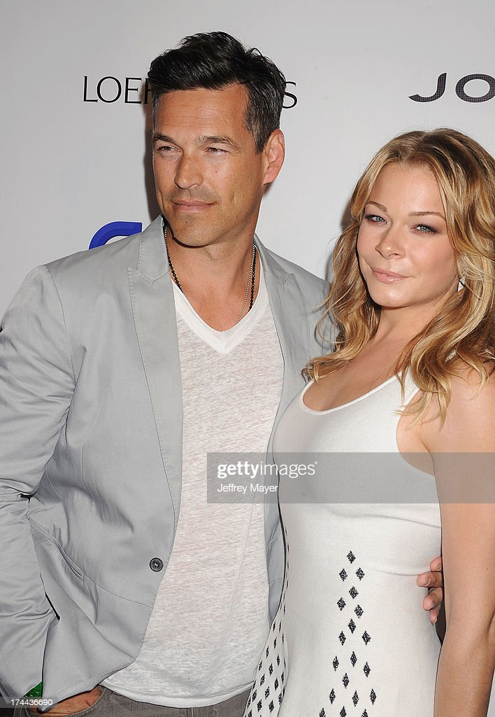 Singer <a gi-track='captionPersonalityLinkClicked' href=/galleries/search?phrase=LeAnn+Rimes&family=editorial&specificpeople=208815 ng-click='$event.stopPropagation()'>LeAnn Rimes</a> (R) and husband actor <a gi-track='captionPersonalityLinkClicked' href=/galleries/search?phrase=Eddie+Cibrian&family=editorial&specificpeople=689383 ng-click='$event.stopPropagation()'>Eddie Cibrian</a> attend the Friend Movement Anti-Bullying Benefit Concert at the El Rey Theatre on July 1, 2013 in Los Angeles, California.