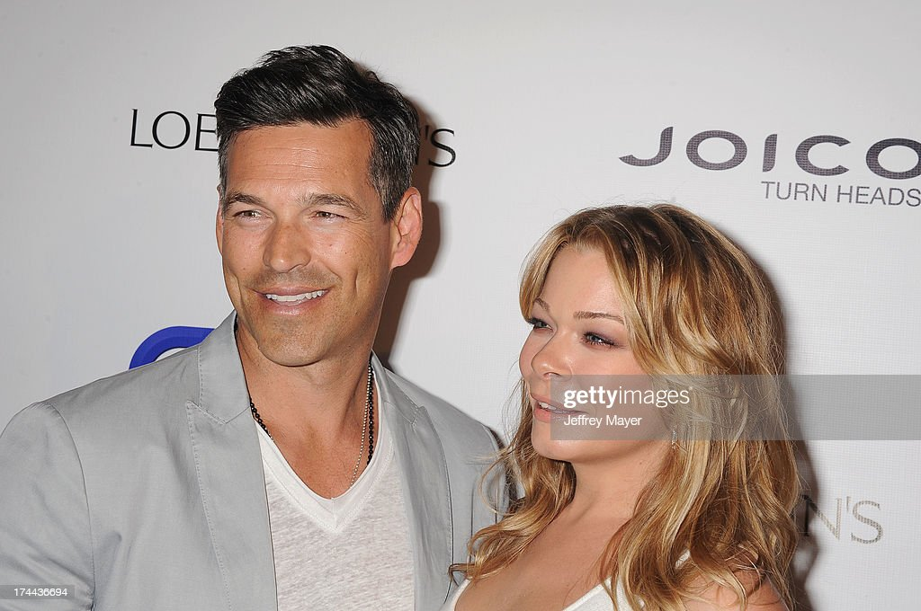Singer LeAnn Rimes (R) and husband actor Eddie Cibrian attend the Friend Movement Anti-Bullying Benefit Concert at the El Rey Theatre on July 1, 2013 in Los Angeles, California.