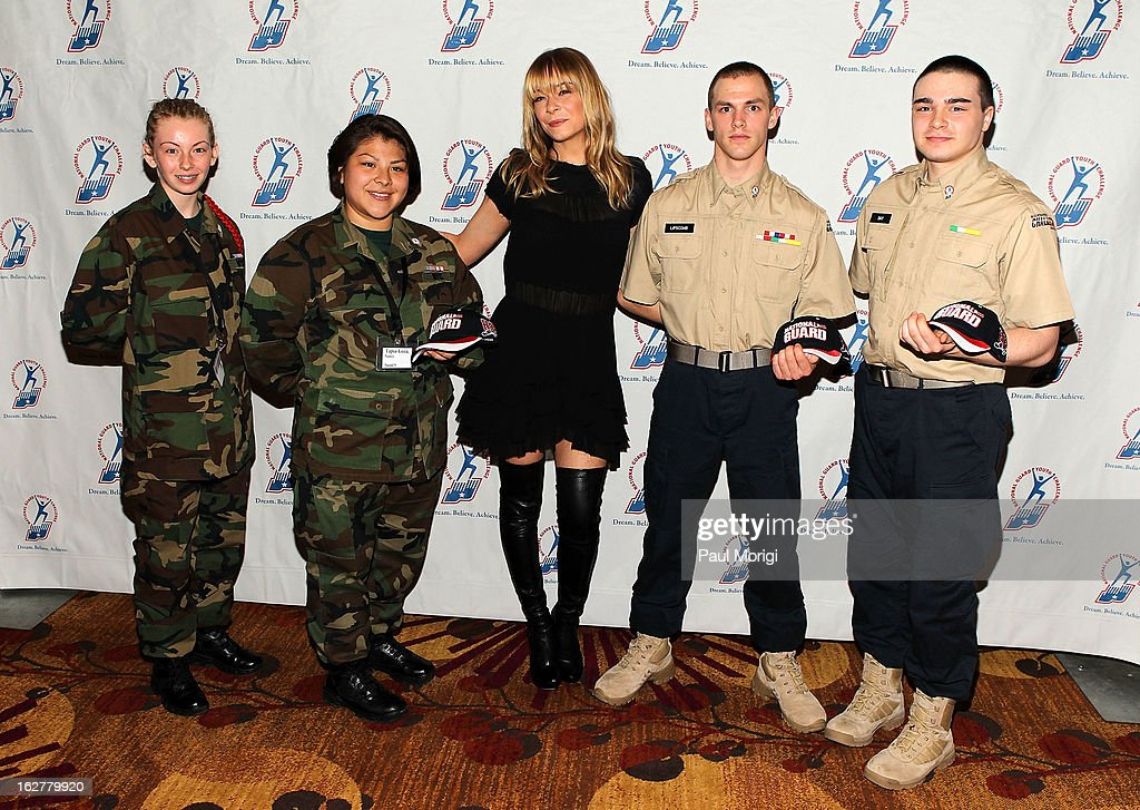 Singer LeAnn Rimes (C) poses for a photo with cadets at the 2013 ChalleNGe Champions Gala at JW Marriott Hotel on February 26, 2013 in Washington, DC.