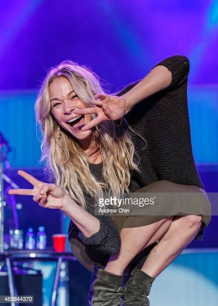 Singer LeAnn Rimes poses for a selfie on stage at PNE Amphitheatre during Day 6 of The Fair At The PNE on August 21 2014 in Vancouver Canada