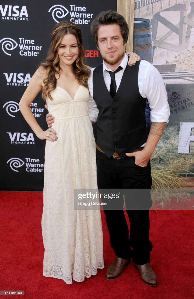 Singer Lee DeWyze (R) and actress/wife Jonna Walsh arrive at 'The Lone Ranger' World Premiere at Disney's California Adventure on June 22, 2013 in Anaheim, California.