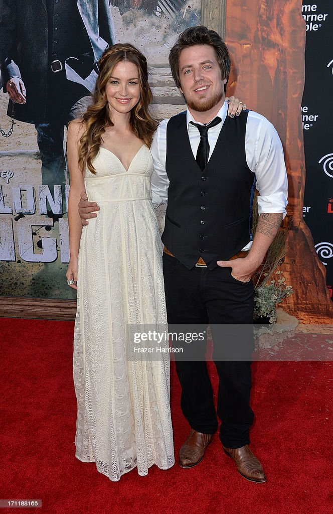 Singer Lee DeWyze (R) and actress/wife Jonna Walsh arrive at the premiere of Walt Disney Pictures' 'The Lone Ranger' at Disney California Adventure Park on June 22, 2013 in Anaheim, California.