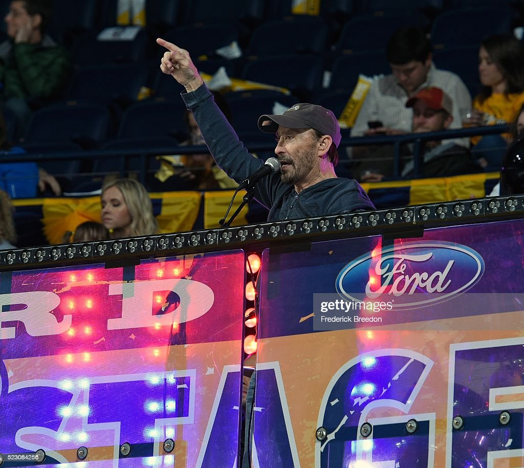 Singer Lee Greenwood performs after the second period in Game Four of the Western Conference First Round between the Nashville Predators and the Anaheim Ducks during the 2016 NHL Stanley Cup Playoffs at Bridgestone Arena on April 19, 2016 in Nashville, Tennessee.