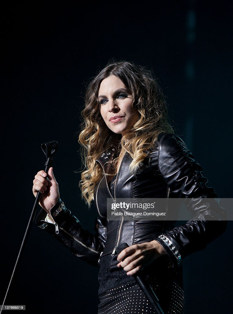 Singer <a gi-track='captionPersonalityLinkClicked' href=/galleries/search?phrase=Leire+Martinez&family=editorial&specificpeople=5437578 ng-click='$event.stopPropagation()'>Leire Martinez</a> of La Oreja de Van Gogh band performs in concert at Arteria Coliseum Theatre on January 24, 2012 in Madrid, Spain.