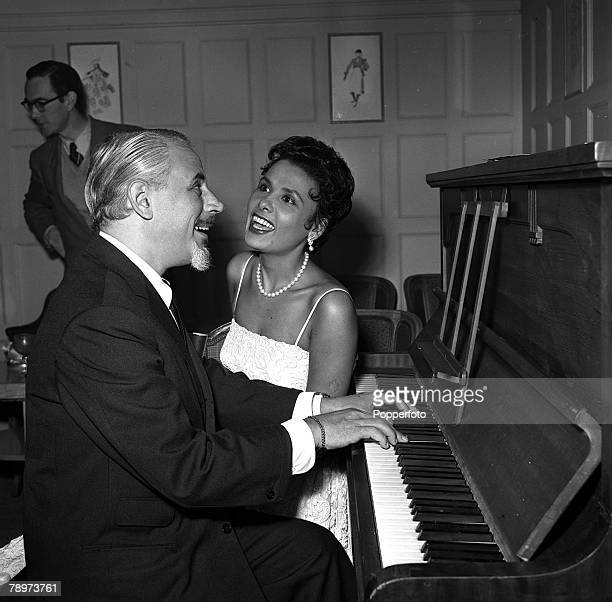 Singer Lena Horne with her husband Lennie Hayton at the piano in London before making her cabaret debut at the Savoy Hotel 1955