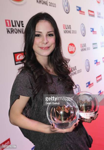 Singer Lena MeyerLandrut holds her Krone Awards for Best Artist and Best Single at the '1Live Krone' Music Awards on December 2 2010 in Bochum Germany
