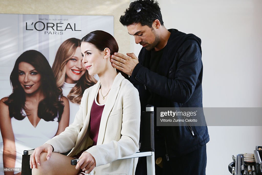 Singer LenaMeyer Landrut is styled by a makeup artist at the L'Oreal cocobello styling studio during the 65th Berlinale International Film Festival...