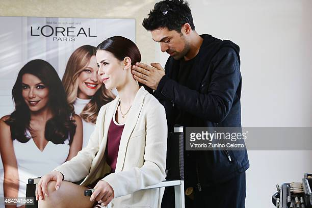 Singer Lena MeyerLandrut is styled by a makeup artist at the L'Oreal cocobello styling studio during the 65th Berlinale International Film Festival...